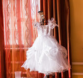Child wedding dress hanging up. A child's wedding dress hanging up. Wedding day royalty free stock photography