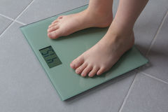 Child weighing up Stock Photos