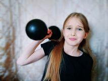 Child with the dumbbell stock images