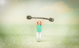 Child weights lifting sport Royalty Free Stock Photos