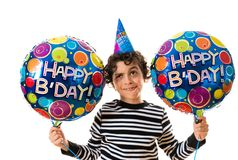 Child Weird Facial Expression during his birthday party. over white background and holding balloons Royalty Free Stock Photo