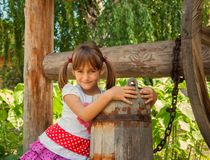 Child at the Well Royalty Free Stock Photo