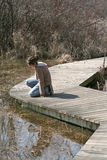 Child on Wetland Trail Stock Photography