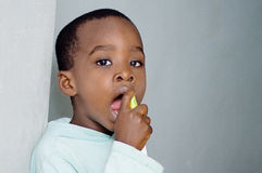 Child wetting the throat. Stock Photography