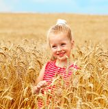 Child in wheat field. Royalty Free Stock Images
