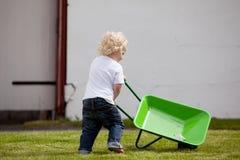 Child with Wheelbarrow Royalty Free Stock Photos