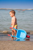 Child with wheelbarrow Royalty Free Stock Images