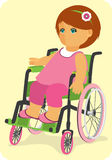 Child in a wheelchair. Cute little doll sits in wheelchair Royalty Free Stock Image