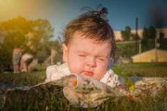 The child is in a wheelchair. A six-month-old girl royalty free stock photography