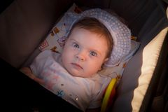 The child is in a wheelchair. A six-month-old girl royalty free stock images