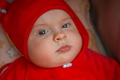 The child is in a wheelchair. A six-month-old girl royalty free stock photos