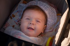 The child is in a wheelchair. A six-month-old girl stock photography