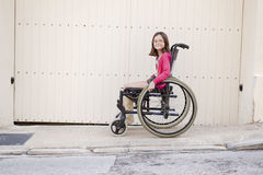 Child in wheelchair royalty free stock image