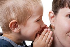 Child whispering. Little human child boy mother ear secrecy whisper Royalty Free Stock Photography