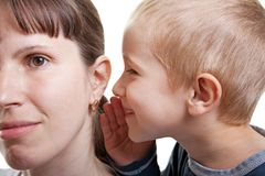 Child whispering. Little human child boy mother ear secrecy whisper Royalty Free Stock Photos