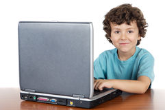 Child whit laptop. A over white background Royalty Free Stock Photos