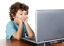 Child whit laptop. A over white background Royalty Free Stock Image