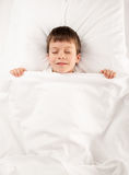 Child in white bed Royalty Free Stock Photography