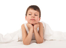 Child in white bed Stock Image