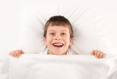 Child in white bed Stock Photo