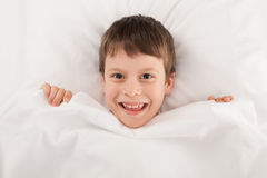Child in white bed Stock Images