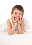 Child in white bed Royalty Free Stock Photo