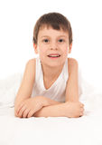 Child in white bed Royalty Free Stock Image