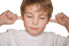 Child in white close eyes and ears Royalty Free Stock Photos