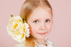 Child in a white dress with a flower in hair Royalty Free Stock Images