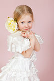 Child in a white dress with a flower in hair Royalty Free Stock Image