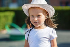 Child in white hat Stock Image