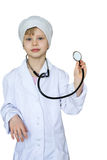 Child in a white medical robe. stock photo