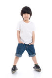 Child  in white t-shirt and jeans standing on white background. Cute Asian child  in white t-shirt and jeans standing on white background isolated Stock Image