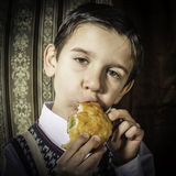 Child who eat. Vintage clothes Royalty Free Stock Image