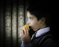 Child who eat. Vintage clothes Stock Photography