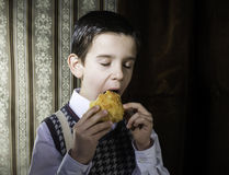 Child who eat. Vintage clothes Royalty Free Stock Photo