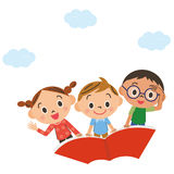 The child who flies in the sky on a book Royalty Free Stock Image