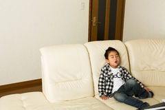 The child who sleeps. The child who lies in the sofa Royalty Free Stock Image