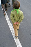 Child who walks with his hands behind his back Stock Photography
