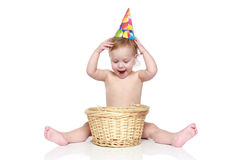 A child with a wicker basket Stock Images