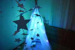 Child wigwam. Wigwam from light garland  in children`s room Stock Images