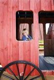 Child wild west wagon. Child with wooden gun in wild west prairie wagon. kid playing in playground stock images