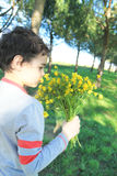 Child with wildflowers. In the garden Royalty Free Stock Photography
