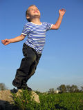Child will jump. Blue sky royalty free stock photos