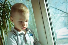 The child at a window Royalty Free Stock Photography