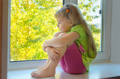 A child at the window. Royalty Free Stock Photography