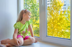A child at the window. Stock Photo