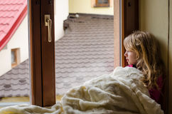 Child by the window Royalty Free Stock Image