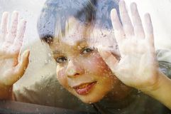 Child and window on a wet rainy day Royalty Free Stock Photography