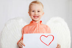 The child with wings of an angel Stock Photos